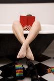 Feet crossed book Stock Photo