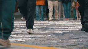 Feet of Crowd People Walking on the Pedestrian Crossing in Slow Motion stock video footage
