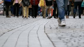 Feet of Crowd People Walking on the Street. Close-up of Crowd feet. Shot of Crowded people walking on street. City Crowd. Many Legs walking along the sidewalk stock video footage