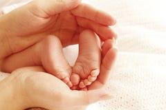 Feet cute newborn little baby Stock Photos