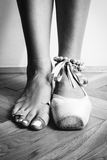 Feet of dancing ballerina. Feet of a ballerina in ballet stock images