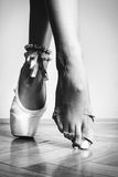 Feet of dancing ballerina. Feet of a ballerina in ballet royalty free stock photos