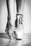 Feet of dancing ballerina. Feet of a ballerina in ballet stock photography