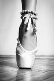 Feet of dancing ballerina. Feet of a ballerina in ballet stock image