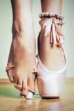 Feet of dancing ballerina Stock Photography