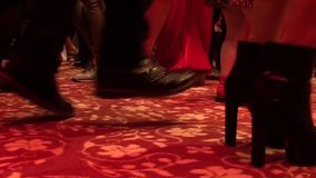 Feet of dancing people indoors 2 stock footage