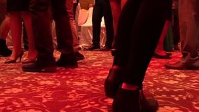 Feet of dancing people indoors stock video