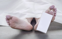 Feet of a deceased man Stock Image