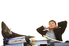 Feet on the desk. Businessman leaning back and putting his feet on his desk Stock Photo