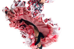 Feet detail of Flamenco dancer in beautiful dress. On white background royalty free stock photos