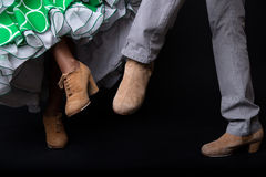 Feet detail of flamenco dancers on black background. Stock Photos