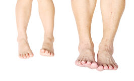 The feet of a different age as child and senior. Concept of two generation Royalty Free Stock Photo