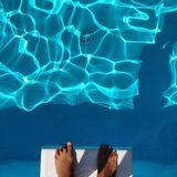 Feet on diving board stock photos