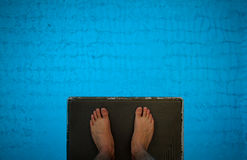 Feet on diving tower Royalty Free Stock Images