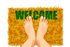 Feet on Door Mat Royalty Free Stock Photography