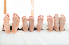 Feet of family. In bed royalty free stock photos