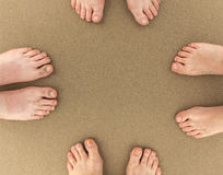 Feet of family of four at the beach Royalty Free Stock Images