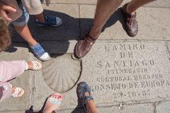 Feet of a family of travelers with shell mark in Obradoiro Squar Stock Photography