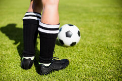 Feet of a female football player and a ball royalty free stock images