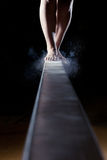 Feet of female gymnast. On balance beam royalty free stock image