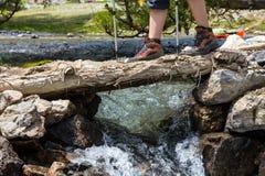Feet of female hiker on bridge Stock Photography