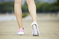 Feet of female runner royalty free stock images