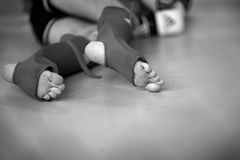 Feet of a fighter wearing protective gear Stock Images