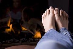 Feet by fire Stock Photos