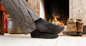 Feet by the fire Royalty Free Stock Photography