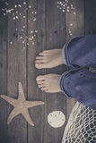 Feet. First-Person view  on rustic wood background. Royalty Free Stock Images
