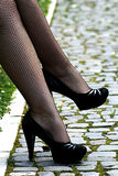 Feet in fishnet stockings Royalty Free Stock Image