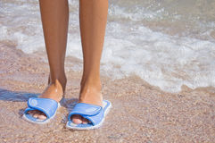 Feet in flip flops at the sea Stock Images