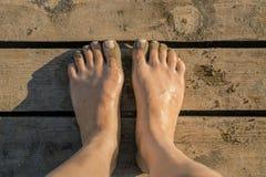Feet on the floor Stock Photo