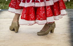 Feet of folk dancer dancing. In a presentation stock image