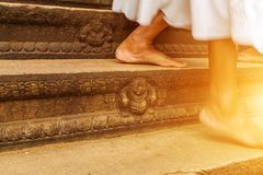 Feet foot female legs sunset. Feet female legs walking inside Woman Up stairs we go at buddha sunset Temple floor royalty free stock images