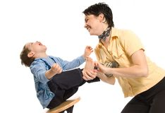 Feet fun. Mom tickling son's feet and laughing hard Stock Image