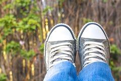 Feet in garden Stock Photos