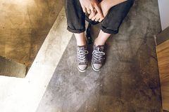 Feet of a girl in modern sneakers. Social network style photo royalty free stock photography