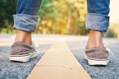 Feet of girl in the road Stock Image