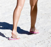 Feet of a girl on the sand Royalty Free Stock Photos