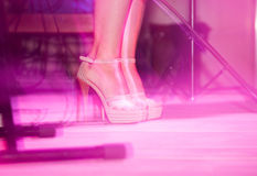 Feet of a girl on stilettos on stage Stock Photo