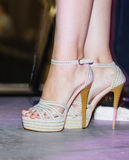 Feet of a girl on stilettos on stage Stock Photography