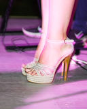 Feet of a girl on stilettos on stage Royalty Free Stock Photography