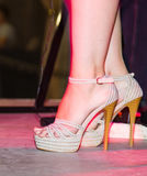 Feet of a girl on stilettos on stage Royalty Free Stock Images