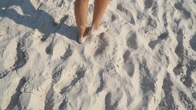 Feet of a girl walking on the sand. Close-up feet of a girl walking on the sand stock footage