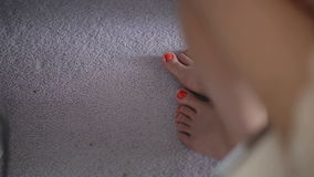 Feet girl on the wooden floor with a nice pedicure stock video footage