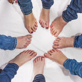 Feet of girls in a circle Stock Photos