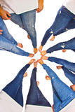 Feet of girls with jeans in a circle Stock Images