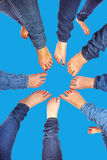 Feet of girls with jeans in a circle. Feet of eight girls with jeans in a circle royalty free stock photo