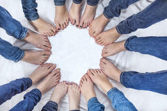 Feet of girls with jeans in a circle. Feet of young girls with jeans in a circle Royalty Free Stock Photo
